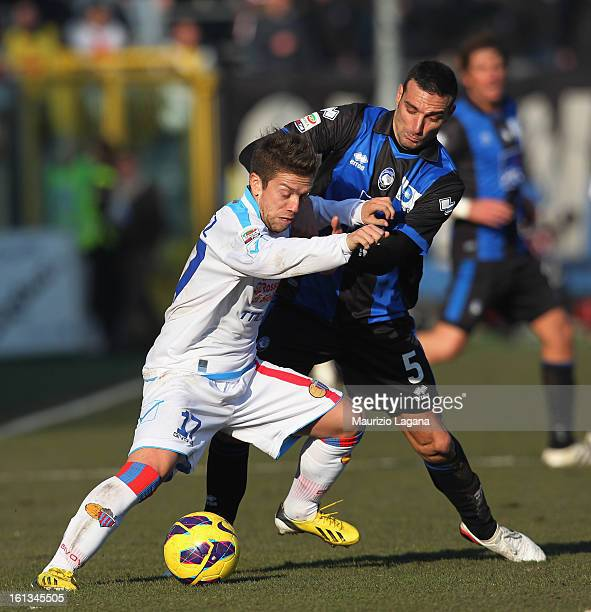 Lionel Scaloni of Atalanta competes for the ball with Alejandro Gomez of Catania during the Serie A match between Atalanta BC and Calcio Catania at...