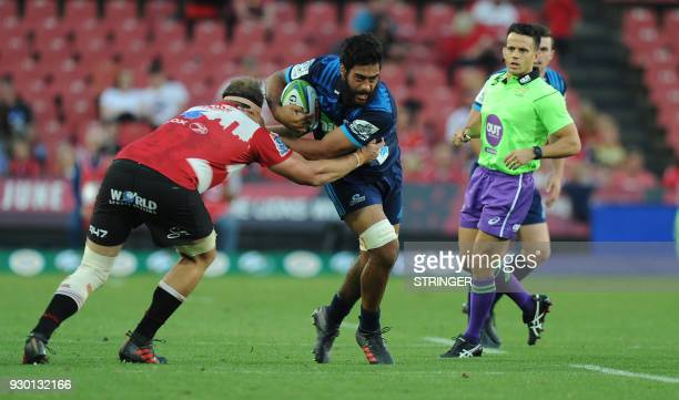 Lions Andries Ferreira tackles Blues Akira Ioane during the Super XV rugby union match between Lions and Blues at Ellis Park Rugby Stadium in...