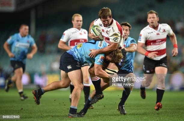 Lions captain player Hacjivah Dayimani is tackled by Waratahs player Michael Hooper during the Super Rugby match between Australia's New South Wales...