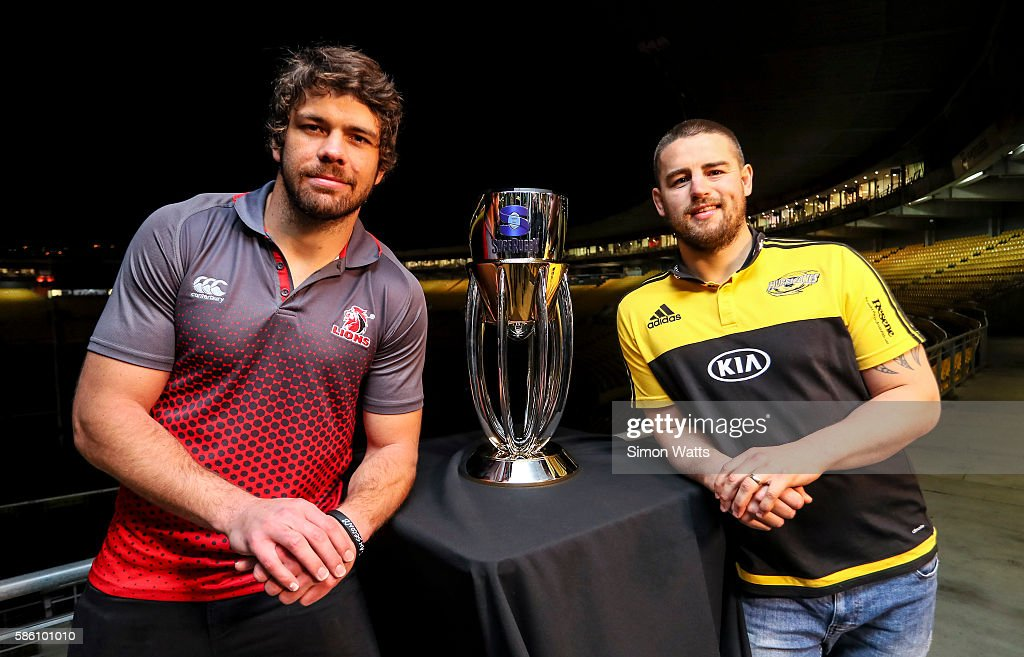 Lions captain Warren Whiteley (L) and Hurricanes captain Dane Coles pose for a photo with the Super Rugby trophy during the Super Rugby Final media opportunity at Westpac Stadium on August 5, 2016 in Wellington, New Zealand.