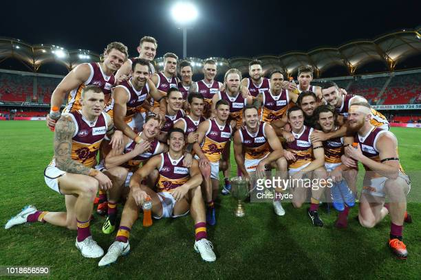 Lions celebrate winning the Q Clash during the round 22 AFL match between the Gold Coast Suns and Brisbane Lions at Metricon Stadium on August 18...