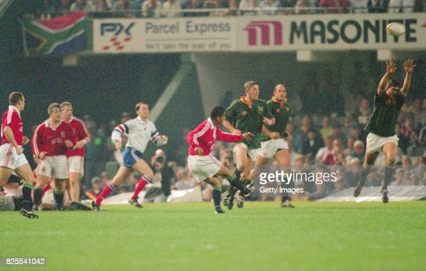 Lions centre Jeremy Guscott kicks the winning drop goal to give the Lions an unbeatable 2-0 series lead during the 2nd Test match between South...