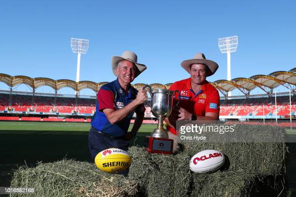 Lions coach Chris Fagan and Suns coach Stuart Dew pose for a photograph for Queensland drought appeal during a Gold Coast SunsBrisbane Lions joint...