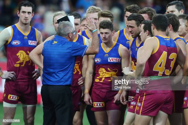 Lions coach Chris Fagan talk to players during the round 20 AFL match between the Brisbane Lions and the Western Bulldogs at The Gabba on August 5...