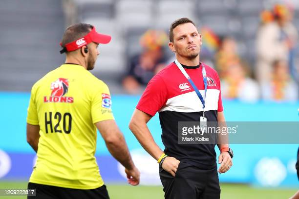 Lions coach Ivan van Rooyen watches on during the warm-up before the round five Super Rugby match between the Waratahs and the Lions at Bankwest...