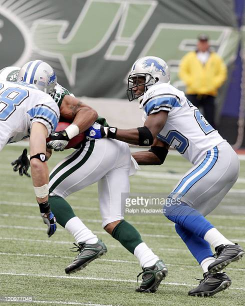 Lions cornerback Fernando Bryant tackles Jets wide receiver Laveranues Coles after a catch during the New York Jets 31 to 24 victory over the Detroit...