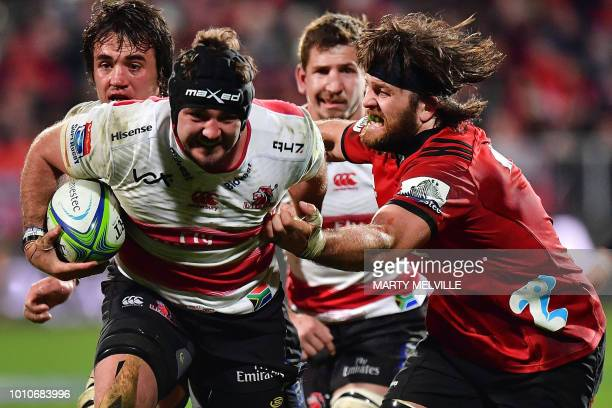 Lions' Cyle Brink is tackled by Crusaders' Heiden BedwellCurtis during the Super Rugby final between the Canterbury Crusaders of New Zealand and the...