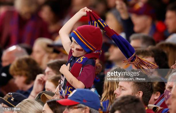Lions fan celebrates during the 2020 AFL Second Preliminary Final match between the Brisbane Lions and the Geelong Cats at The Gabba on October 17,...