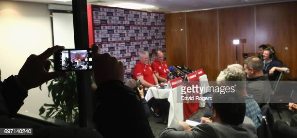 Lions fan photographs Warren Gatland and Rory Best of the Lions from the car park as they face the media in a cramped conference room during the...