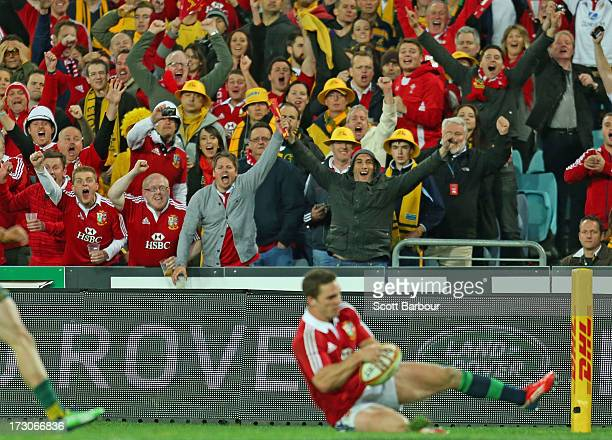 Lions fans celebrate as George North of the Lions scores a try during the International Test match between the Australian Wallabies and British Irish...