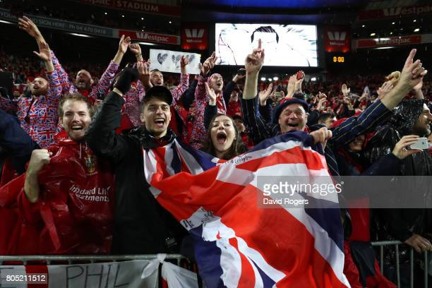 Lions fans celebrate following their team's 2421 victory during the second test match between the New Zealand All Blacks and the British Irish Lions...