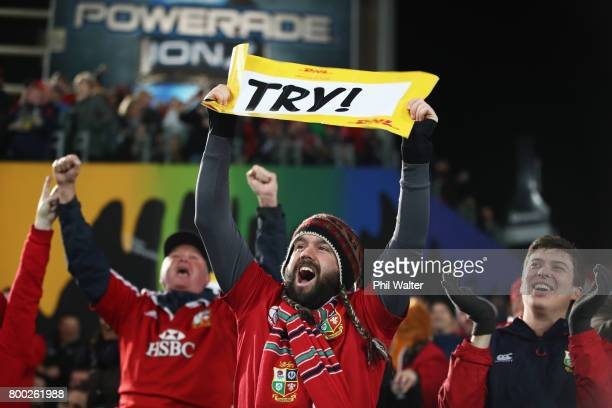 Lions fans celebrate the try scored by Sean O'Brien during the first test match between the New Zealand All Blacks and the British Irish Lions at...