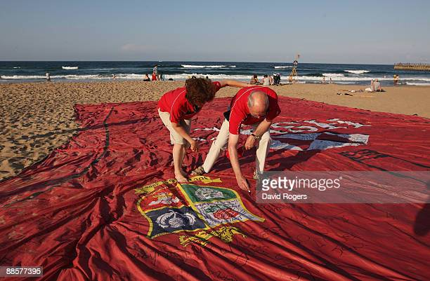 Lions fans sign a giant shirt on North Beach on June 19 2009 in Durban South Africa