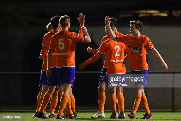 Lions FC players celebrate a Nathan Shepherd goal during the NPL Semi Final match between Lions FC and Heidelberg United at Lions Stadium on...