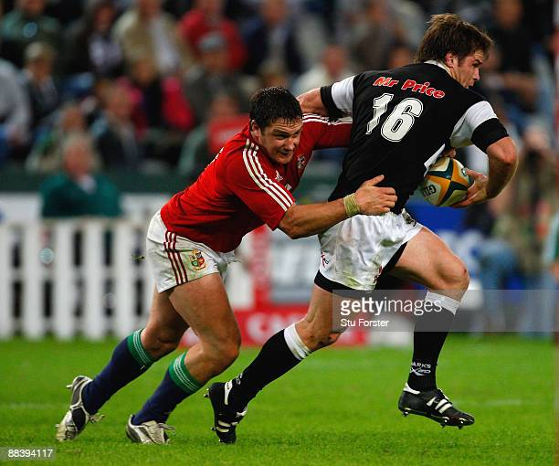 Lions forward David Wallace tackles Sharks player Craig Burden during the match between The Sharks and The British and Irish Lions at Absa Stadium on...