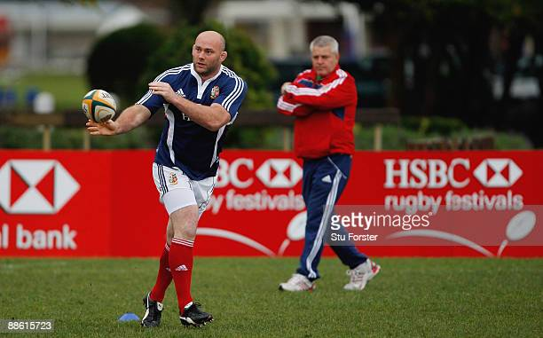 Lions forward John Hayes passes the ball under the eye of coach Warren Gatland during British and Irish Lions training at Bishops school on June 22,...