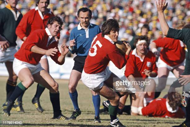 Lions fullback Andy Irvine in action as captain Bill Beaumont looks on during the 2nd Test match between South Africa and the British and Irish Lions...