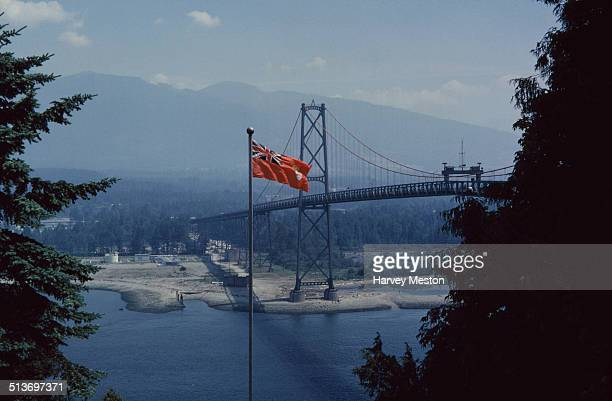 Lions Gate Bridge a suspension bridge across Burrard Inlet from Prospect Point in Stanley Park Vancouver British Columbia Canada circa 1960 The old...