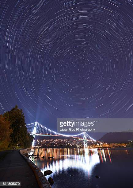 lions gate bridge and star trails, night at stanley park, vancouver - grouse mountain stock photos and pictures