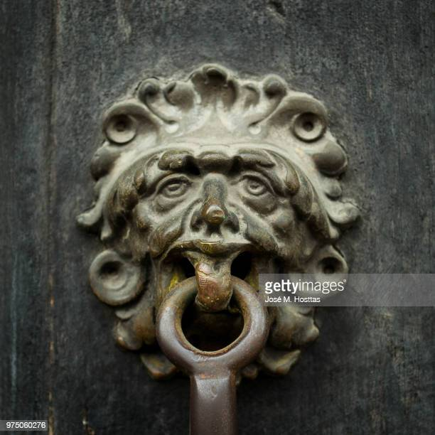 lion's gate - door knocker stock photos and pictures