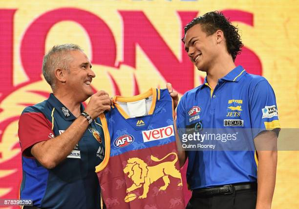 Lions head coach Chris Fagan poses with Cameron Rayner during the 2017 AFL Draft at Sydney Showgrounds on November 24 2017 in Sydney Australia