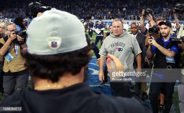 Lions head coach Matt Patricia is pictured heading towards Patriots head coach Bill Belichick for the post game handshake following the Detroit...