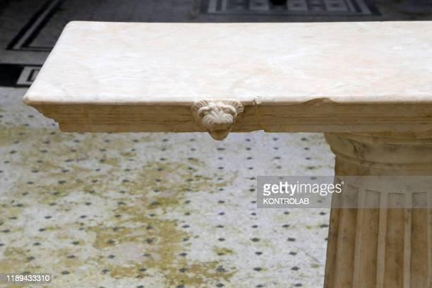 A lion's head decorating a marble table in in the Orchard House so named for the frescoes depicting fruit tree in two cubicle In the archaeological...