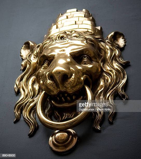 lion's head - door knocker stock photos and pictures