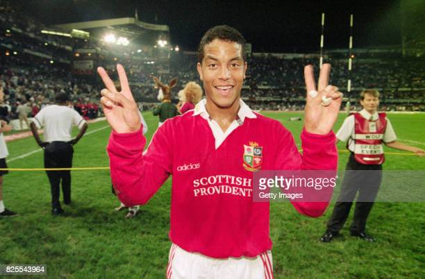 Lions hero Jeremy Guscott celebrates after his drop goal had given the Lions a 2-0 Series lead after the 2nd Test match between South Africa and...