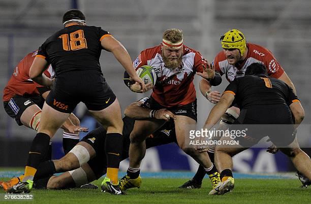 Lions' hooker Akker van der Merwe is tackled by Jaguares' flanker Javier Ortega Desio during their Super Rugby match at Jose Amalfitani stadium in...