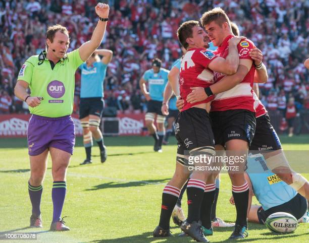 Lions' Kwagga Smith celebrates with Lions' Malcolm Marx after scoring a try during the Super Rugby semifinal match between South Africa's Lions and...