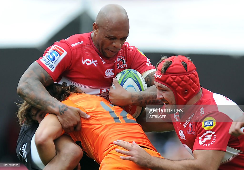 Lions Lionel Mapoe is tackled by Jaguares Bautista Ezcurra as Lions Cyle Brink supports during the SUPERXV Rugby match between Lions and Jaguares at Ellis Park Rugby Stadium on February 24, 2018 in Johannesburg, South Africa. /