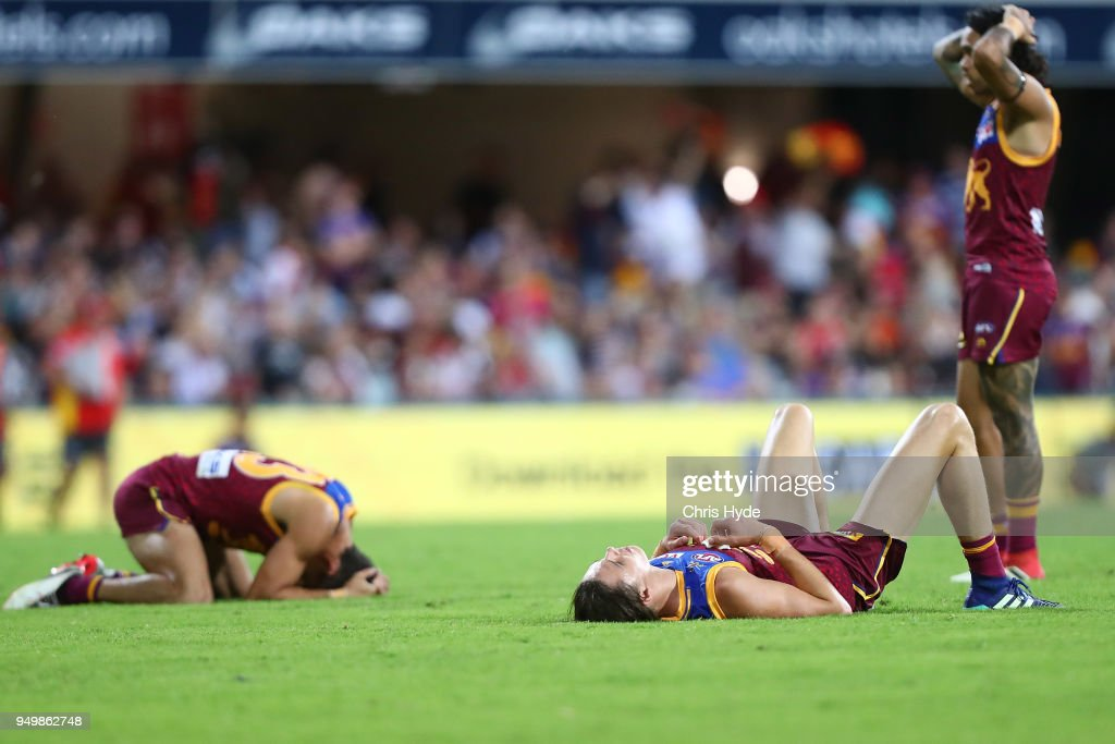 Lions look on after losing the round five AFL match between the Brisbane Lions and the Gold Coast Suns at The Gabba on April 22, 2018 in Brisbane, Australia.