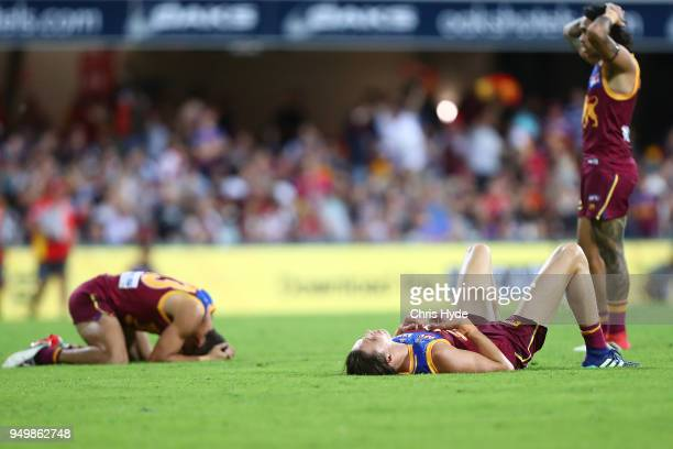 Lions look on after losing the round five AFL match between the Brisbane Lions and the Gold Coast Suns at The Gabba on April 22 2018 in Brisbane...