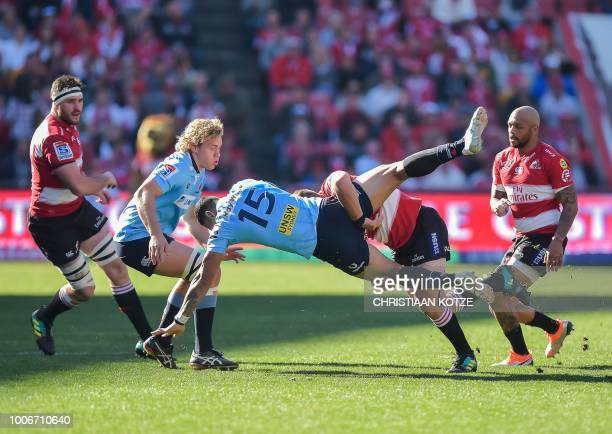 TOPSHOT Lions' Malcolm Marx tackles The Waratahs' Israel Folau during the Super Rugby semifinal match between South Africa's Lions and Australia's...