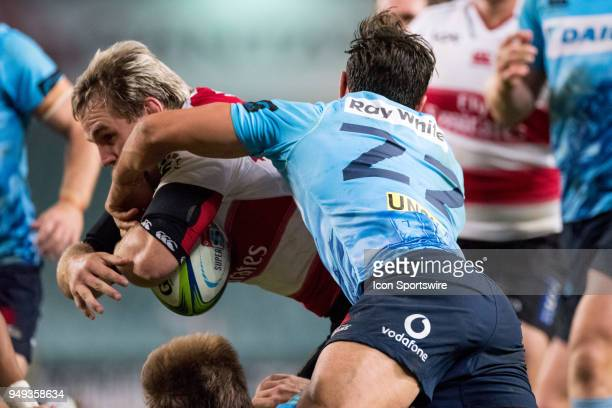 Lions player Marnus Schoeman breaks the tackle of Waratahs player Nick Phipps to score at week 10 of the Super Rugby between The Waratahs and Lions...