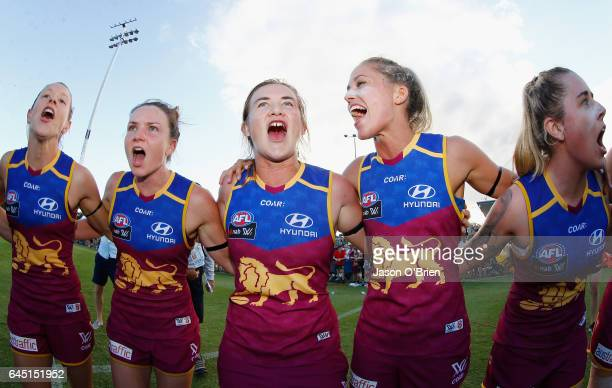 Lions players celebrate their win by singing the team song during the round four Women's AFL match between the Brisbane Lions and the Greater Western...