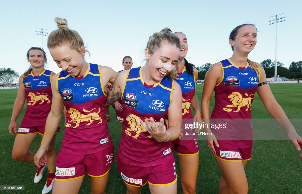 Lions players celebrate their win by singing the team song during the round four Women's AFL match between the Brisbane Lions and the Greater Western Sydney Giants at South Pine Complex on February 25, 2017 in Brisbane, Australia.