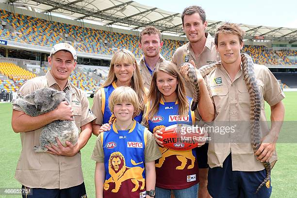 Lions players Dayne Zorko Pearce Hanley Matthew Leuenberger and Zac O'Brien pose for a photo with Terri Robert and Bindi Irwin during a Brisbane...