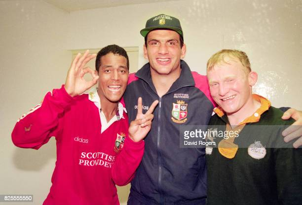 Lions players Jeremy Guscott Martin Johnson and Neil Jenkins celebrate in the dressing room after victory in the 2nd Test match between South Africa...