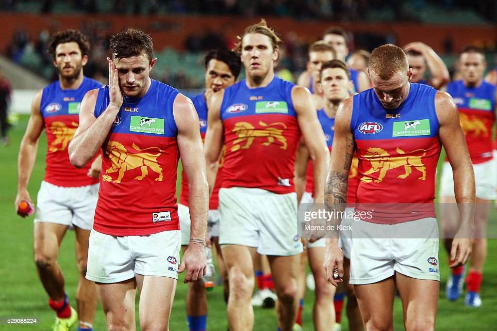 Lions players leave the field after losing during the round seven AFL match between the Port Adelaide Power and the Brisbane Lions at Adelaide Oval on May 8, 2016 in Adelaide, Australia.