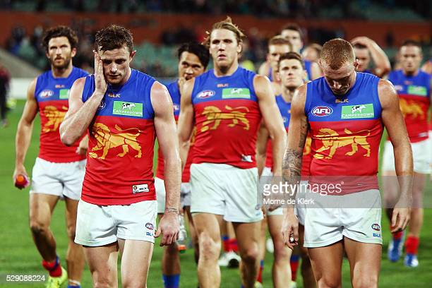 Lions players leave the field after losing during the round seven AFL match between the Port Adelaide Power and the Brisbane Lions at Adelaide Oval...