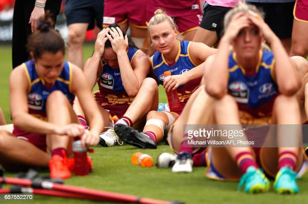 Lions players look dejected after a loss during the 2017 AFLW Grand Final match between the Brisbane Lions and the Adelaide Crows at Metricon Stadium...