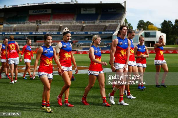 Lions players look dejected after the AFLW Semi Final match between the Carlton Blues and the Brisbane Lions at Ikon Park on March 22 2020 in...