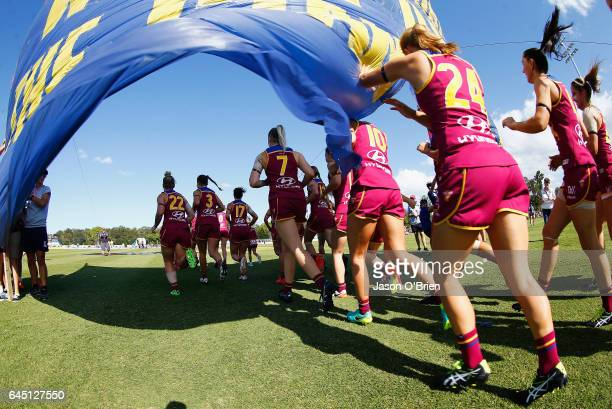 Lions players take the field during the round four Women's AFL match between the Brisbane Lions and the Greater Western Sydney Giants at South Pine...