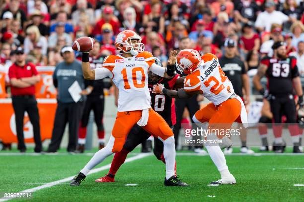 Lions quarterback Jonathon Jennings prepares to make a pass during Canadian Football League action between BC Lions and Ottawa RedBlacks on August 26...