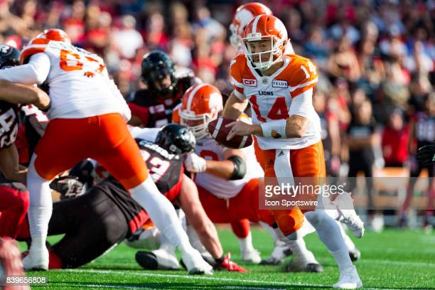 Lions quarterback Travis Lulay runs with the football during Canadian Football League action between BC Lions and Ottawa RedBlacks on August 26 2017...