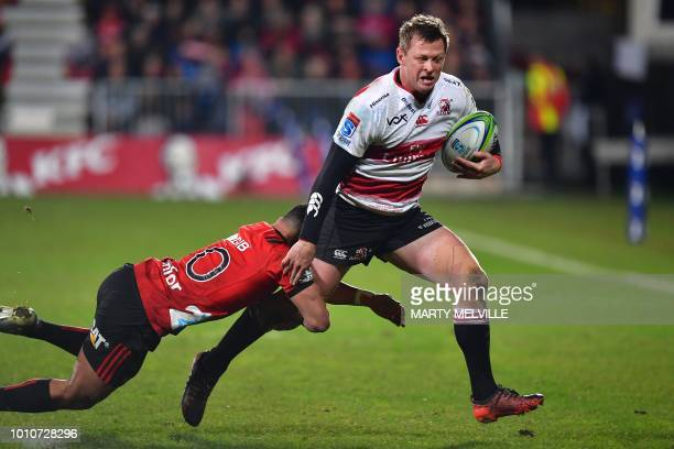 Lions' Ruan Combrinck is tackled by Crusaders' Richie Mo'unga during the Super Rugby final between the Canterbury Crusaders of New Zealand and the...