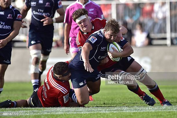 RSA Lions' Ruan Dreyer is tackled by Crusaders' Cosie Taylor and Andries Ferreira during the Super 15 Rugby Union match between the Crusaders against...