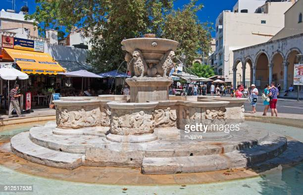 lions square with fountain, heraklion - herakleion stock photos and pictures